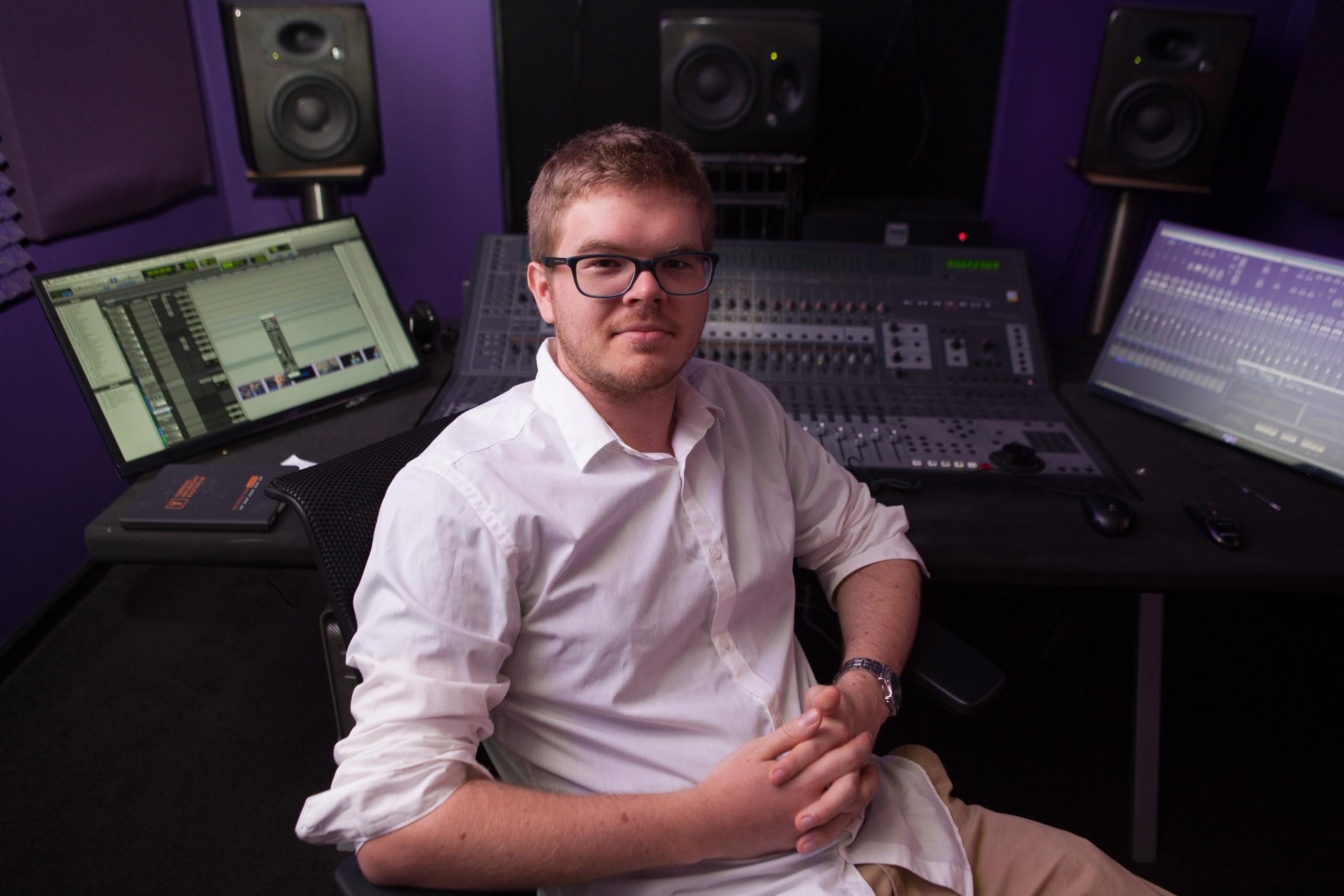 Sitting in front of studio (best)