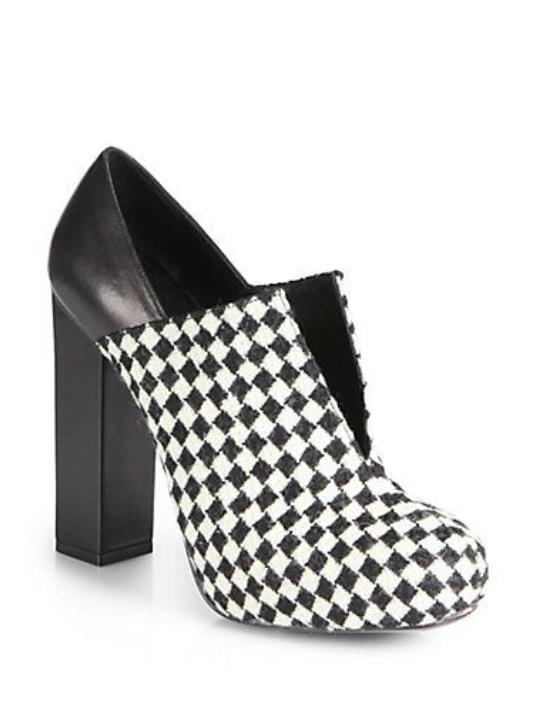 Charline De Luca black and white heels